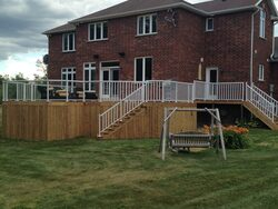 Image of pressure treated deck with aluminum railing