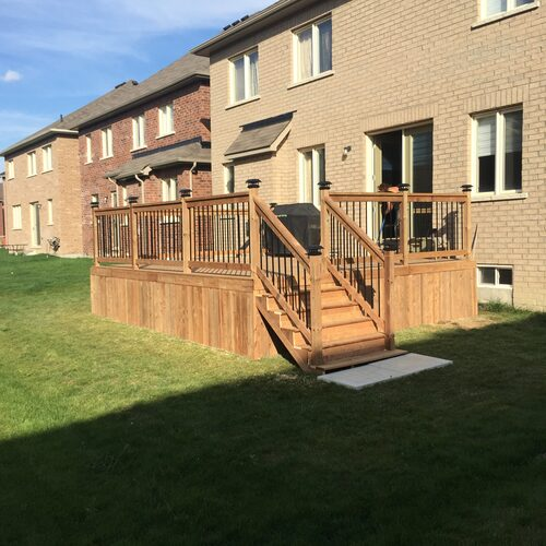 Image of pressure treated deck with aluminum pickets
